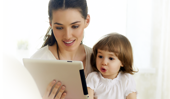 woman and child looking at tablet